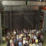 More than 200 scientists from Brazil, France, Greece, Russia, United Kingdom and the United States are involved in the project. Some of them are shown here in front of a prototype detector plane built at Fermilab. There is also a photo of collaboration members at a workshop in Minnesota in June 2000 taken by Jerry Meier, University of Minnesota.