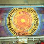 """he University of Minnesota Foundation commissioned a mural for the MINOS cavern, painted onto the rock wall, 59 feet wide by 25 feet high. The mural's fiery central focus area contains images of scientists such as Enrico Fermi and Wolfgang Pauli, Wilson Hall at Fermilab, George Shultz, a key figure in the history of Minnesota mining, and a number of surprises. """"I've included the word 'change' in as many languages as people could give me translations for it,"""" said Joe Giannetti of Minneapolis, the artist who was featured in a National Geographic television documentary about the MINOS project. """"Neutrinos are changing all the time-just as we are, just as the universe is. I'm fascinated by neutrino science, and I admire the imaginations of the scientists. A scientist had to imagine this experiment, this series of detectors. This place is a temple of the human imagination."""""""