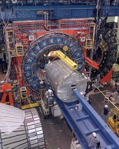 "The CDF detector, about the size of a 3-story house, weighs about 6,000 tons. Its subsystems record the ""debris"" emerging from high-energy proton-antiproton collisions. The detector surrounds the collision point and records the path, energy and charge of the particles emerging from the collisions. This information can be used to determine, for example, the mass of the W boson, the carrier of the weak nuclear force and a key parameter of the Standard Model of particles and forces"