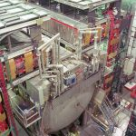 The DZero detector records particles emerging from high-energy proton-antiproton collisions produced by the Tevatron. Tracing the particles back to the center of the collision, scientists understand the subatomic processes that take place at the core of proton-antiproton collisions. Scientists search for the tiny fraction of collisions that might have produced a Higgs boson.