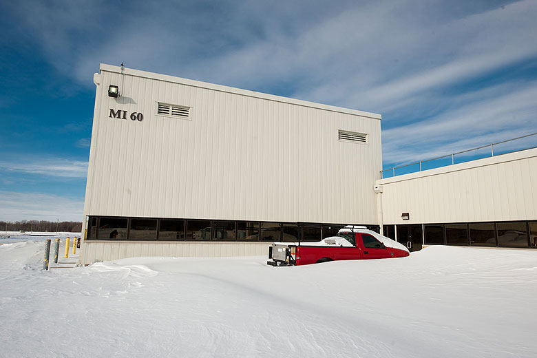 A pickup truck is half buried in snow outside of the MI-60 building on Feb. 2 after a blizzard dumped more than 15 inches of snow on the laboratory. Photo: Reidar Hahn