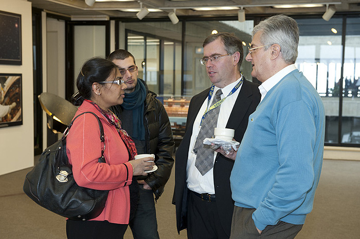 The visitors from the French consulate, including Adele Martial, had a chance to meet with Fermilab users (from right) Elemer Nagy (Marseille), Christophe Royon (CEA-Saclay) and Jonathan Brown (Paris VI). Photo: Reidar Hahn