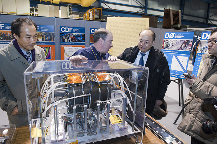 The visit included a tour of the 15th floor, CDF, the SRF Accelerator Test Facility and the Dark Energy Camera. CDF co-spokesperson Rob Roser (second from left) explained how the detector works to (from left), Byung-Hoon Oh, director and senior researcher at the Korea Atomic Energy Research Institute, Dong-Pil Min, Chairman of the Korea Research Council of Fundamental Science and Technology, and Whanyung Kim, a reporter from Joong Ang Ilbo. Photo: Reidar Hahn.