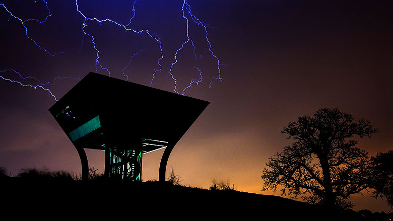 Lightning over the Proton Pagoda on site early Monday morning. Photo: Marty Murphy, AD