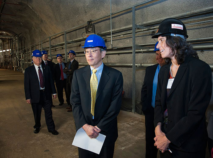 MINERvA experiment co-spokesperson Debbie Harris gives Energy Secretary Steven Chu a tour of the MINOS underground experimental hall, where the MINERvA experiment is located. Joining Chu on the tour were Universities Research Association, Inc. Executive Chair Steven Beering, visible on the left, and Deputy Manager of the DOE Fermi Site Office Mark Bollinger, visible behind Harris. Chu visited the laboratory on June 2. Photo: Reidar Hahn.