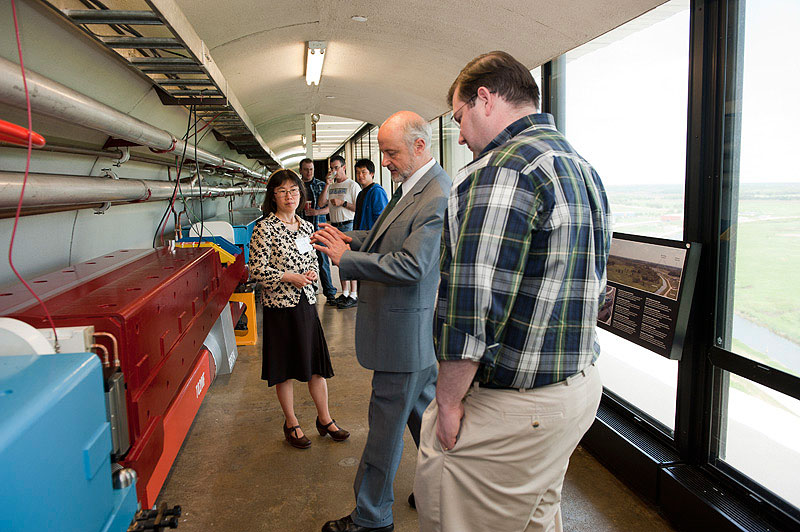 Young-Kee Kim, Fermilab's deputy director, and Pier Oddone, Fermilab director, give a tour of the 15th floor to Tom Craig, a staff member on the Senate Committee on Appropriations - Energy and Water Development Subcommittee on June 1. During his visit to the laboratory, Craig also toured the SRF Test Facility and the MINOS Underground Facility. Photo: Reidar Hahn.