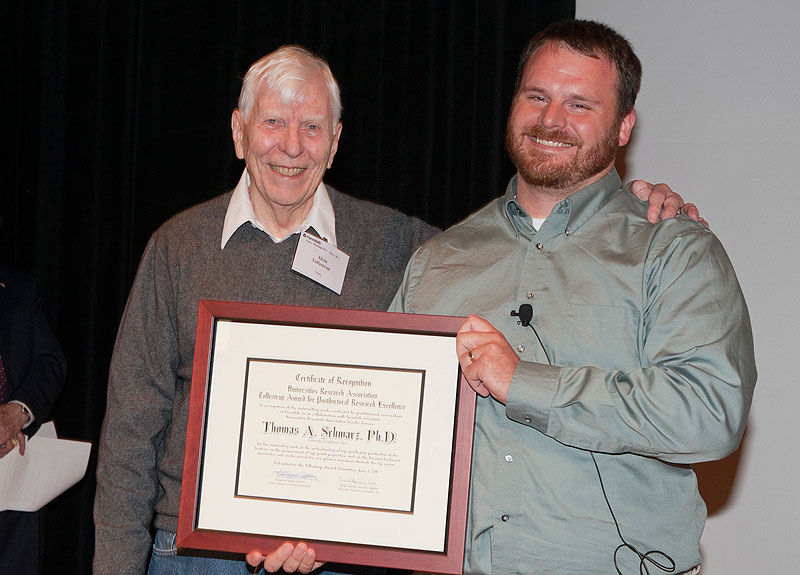 Tom Schwarz, a CDF collaborator from the University of California-Davis, receives the Tollestrup Award from Alvin Tollestrup at the 2011 annual Users' Meeting. Schwartz received the award for his postdoctoral work on measurements of top quark properties. Photo: Reidar Hahn.