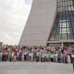 Some of the 500 scientists of the CDF collaboration in front of Wilson Hall at Fermilab.
