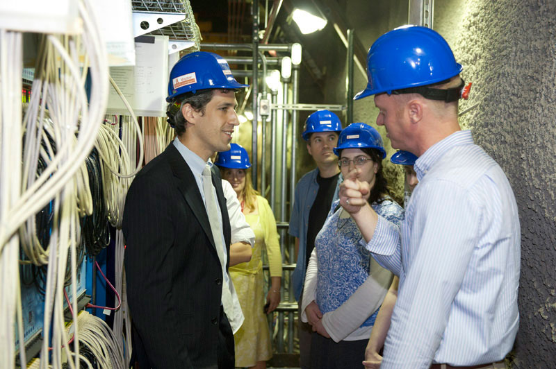 Fermilab scientist Dave Schmitz (right) describes the MINERvA and MINOS experiments to Illinois State Senator Daniel Biss (left) on his tour at Fermilab on June 29. His visit also included stops at CDF and the Superconducting Radio Frequency Test Facility. Also pictured are (center left to right) Fermilab's Elizabeth Clements and Jamie Santucci, as well as Gabriella Elkaim, an intern in Senator Biss' office.