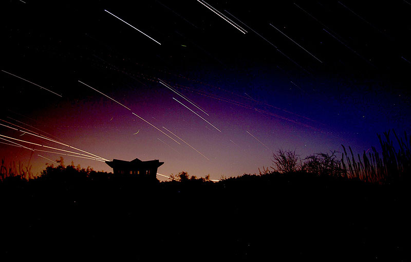 Shortly after nightfall on June 28, stars streaked the sky above the gazebo in the center of the Tevatron ring. Photo: Jeff Simmons, AD.