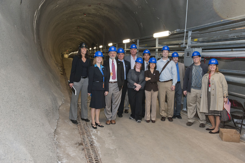 On Sept. 27, a group visiting from DOE's Office of Science and staffers from the U.S. House of Representatives Science, Space, and Technology Committee toured Fermilab's underground neutrino facility. From left: Debbie Harris, Fermilab; Katie Yurkewicz, Fermilab; Pier Oddone, Fermilab; Mark Bollinger, DOE; Jim Siegrist, DOE; Kirsten Duncan, House Science Committee; Marcos Huerta, DOE; Young-Kee Kim, Fermilab; Dan Byers, House Science Committee; Rob Plunkett, Fermilab; Andy Zach, House Science Committee; Elizabeth Clements, Fermilab. Photo: Reidar Hahn