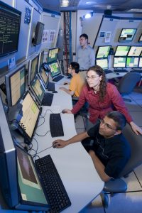 Control room for CDF where particle sprays from collisions are analyzed.
