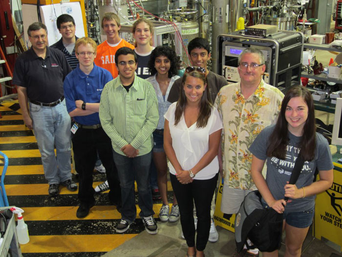 Students and teachers in the QuarkNet Summer Research for High School Students program smile for the camera. View the projects they worked on this summer.