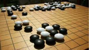 Much like the game of go, the basic rules of the electromagnetic force are simple, yet they play out in complex ways.