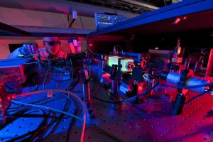 "Ray Tomlin tunes the laser in the Holometer lab. Photo: ""Headless"" Reidar Hahn"