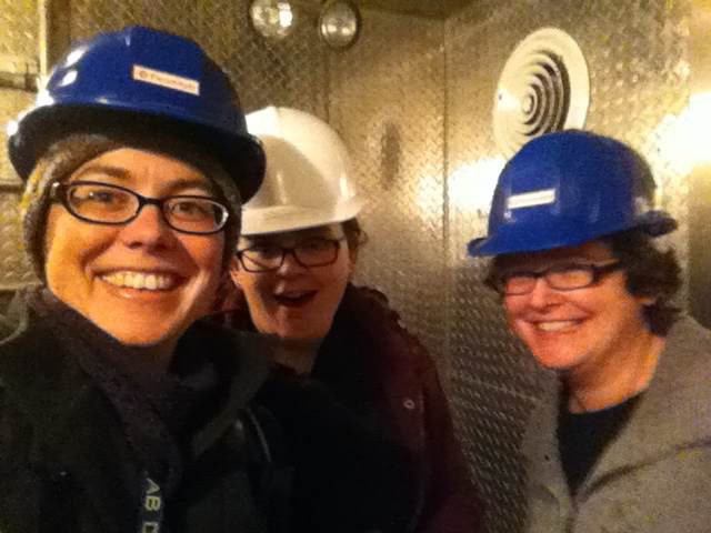 Last week a front-end electronics board for MINERvA was replaced by a team of detector experts — who coincidentally all happened to be women. This is the first time an all-female team has performed this task. Dr. Carrie McGivern took a celebratory picture on the elevator on the way up to the surface from the underground detector. From left: Dr. Carrie McGivern, University of Pittsburgh; Anne Norrick, College of William and Mary; Prof. Emily Maher, Massachusetts College of Liberal Arts. Photo: Carrie McGivern