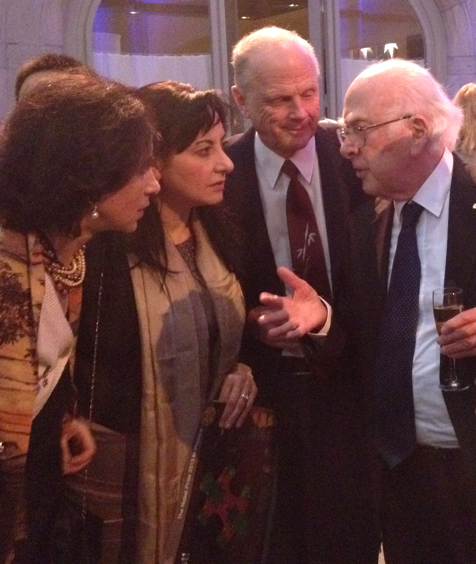 Nobel Prize winner Peter Higgs tells a story to rapt listeners at the Dec. 9 Nobel Prize ceremony reception in Stockholm, Sweden. From left: ATLAS Spokesperson Fabiola Gianotti, Fermilab and University of Chicago scientist Marcela Carena, Physics Nobel Prize Committee Chair Lars Brink, Peter Higgs. Photo courtesy of Marcela Carena, PPD and University of Chicago, and Carlos Wagner, Argonne and University of Chicago
