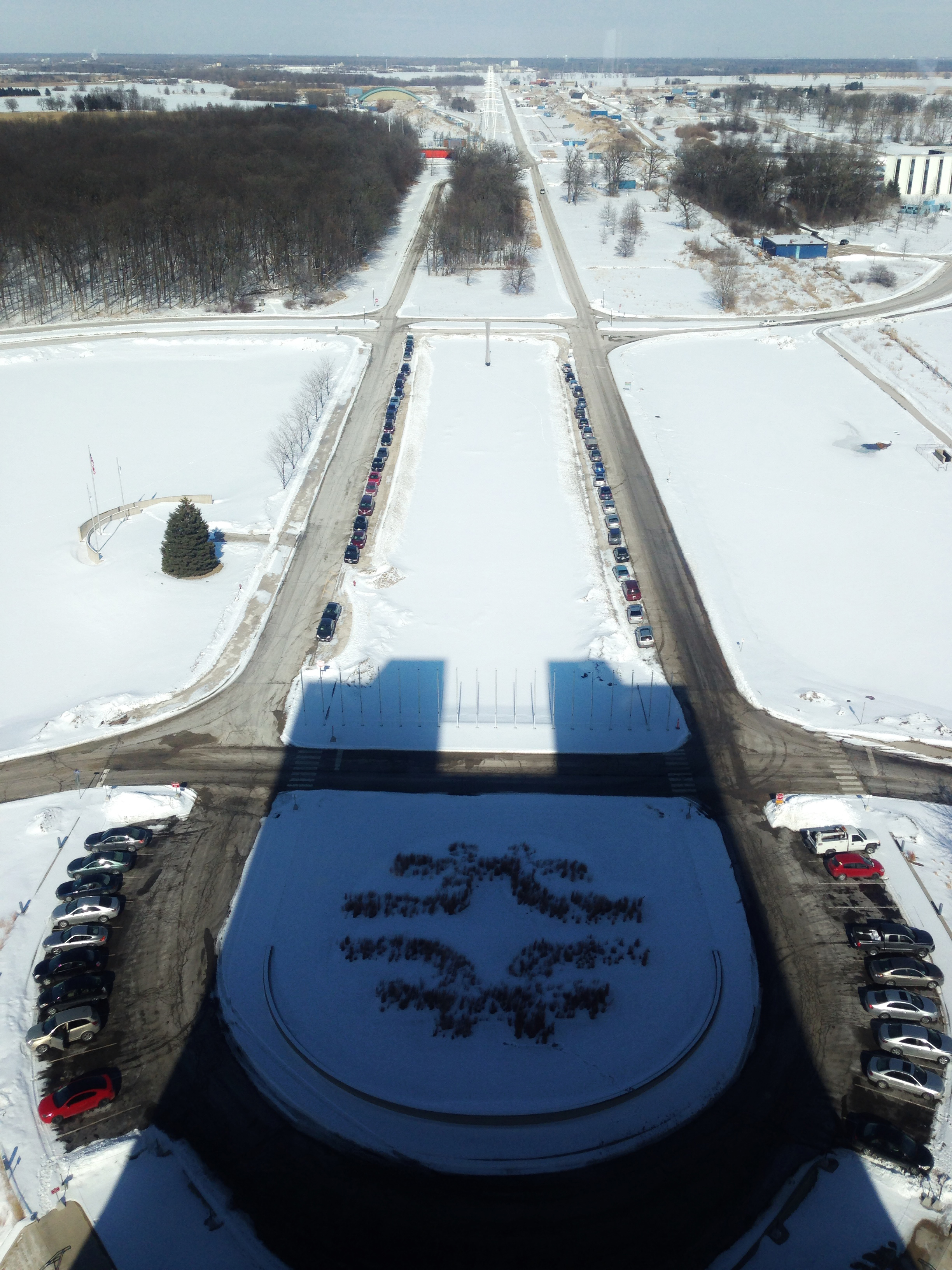 At 2:10 p.m. on Tuesday, the 100th anniversary of Robert Wilson's birth, the shadow of Wilson Hall aligned perfectly with Road A near Wilson Hall. See part 2. Photo: Gene Kafka, Illinois Institute of Technology