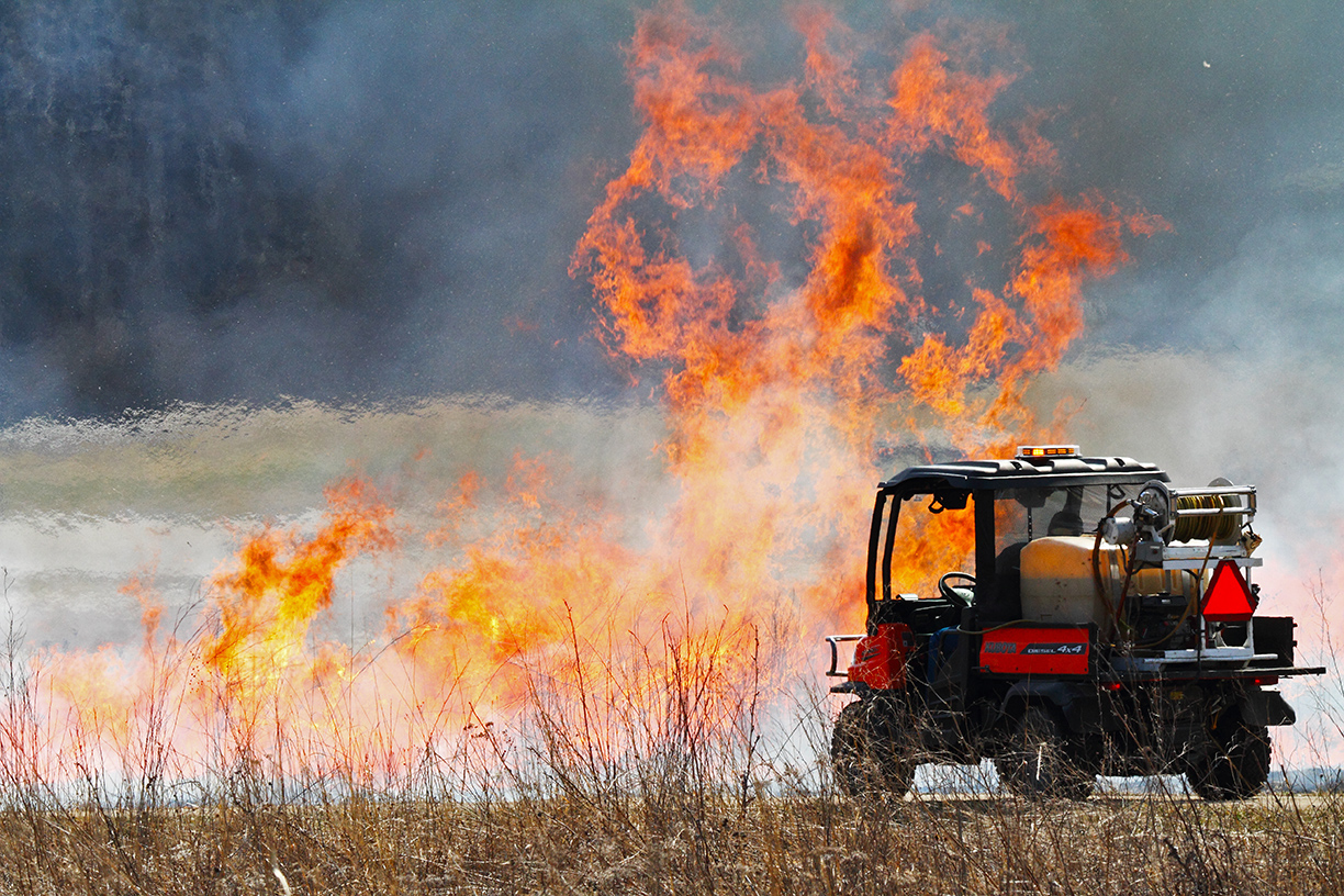 Fermilab Today reader Gordon Garcia of Bartlett, Ill., took this photo of a controlled burn at the prairie east of the Pine Street entrance to Fermilab. The Fermilab Roads and Grounds crew uses small vehicles to transport equipment and monitor prairie burns. Photo: Gordon Garcia