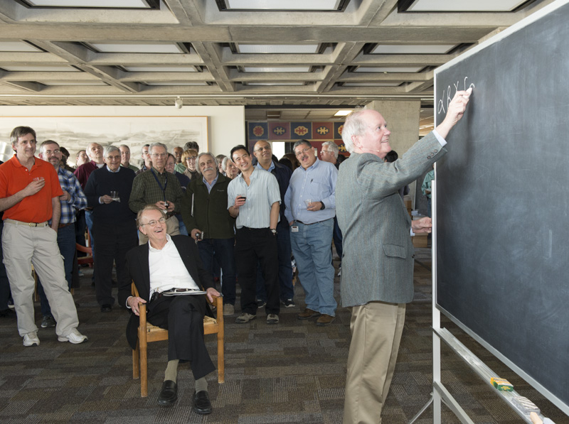 Fermilab's Chris Quigg explains the connection between quantum electrodynamics and Feynman diagrams in a brief talk on the exhibit. Photo: Reidar Hahn