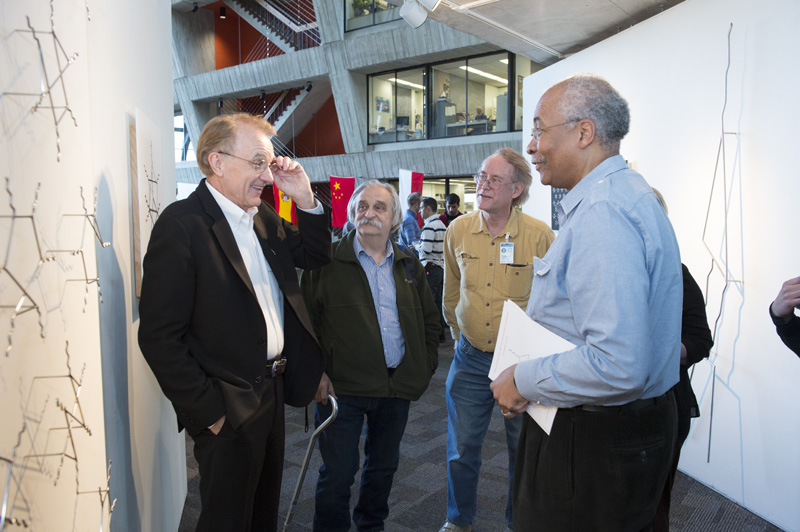 """Artist and visualization master Edward Tufte talks to attendees at the reception for his art exhibit """"The Cognitive Art of Feynman Diagrams,"""" which can be viewed in the Fermilab Art Gallery. Photo: Reidar Hahn"""