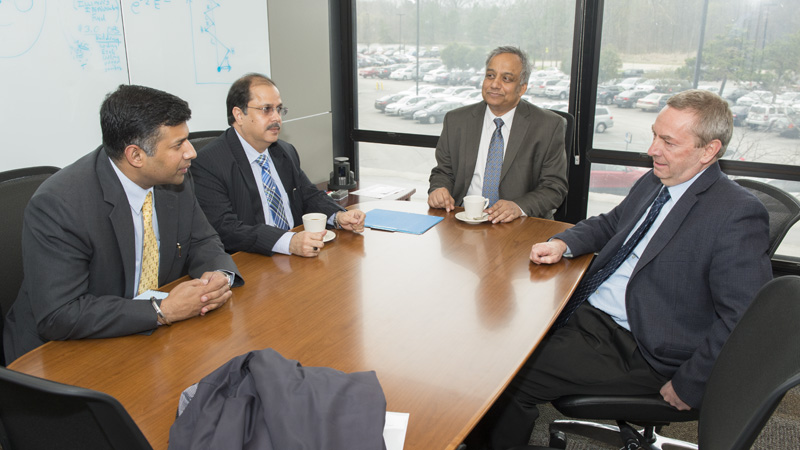 On Monday, senior officials of the government of India visited Fermilab. Vikram Doraiswami, left, briefed Fermilab Director Nigel Lockyer on the approval status of the DAE-DOE Discovery Science Collaboration agreements for PIP-II and LBNE. Doraiswami stated that the collaboration is of strategic importance for both countries. Lockyer stressed the importance of Indian collaboration to the Fermilab and U.S. high-energy physics program. From left: Joint Secretary Vikram Doraiswami, Indian Ministry of External Affairs; India Consul General Ausaf Sayeed, Chicago; Fermilab scientist Shekhar Mishra, U.S. Technical Coordinator, Discovery Science Collaboration; Fermilab Director Nigel Lockyer. Not pictured: India Consul Debashish Banerjee, Chicago. Photo: Reidar Hahn