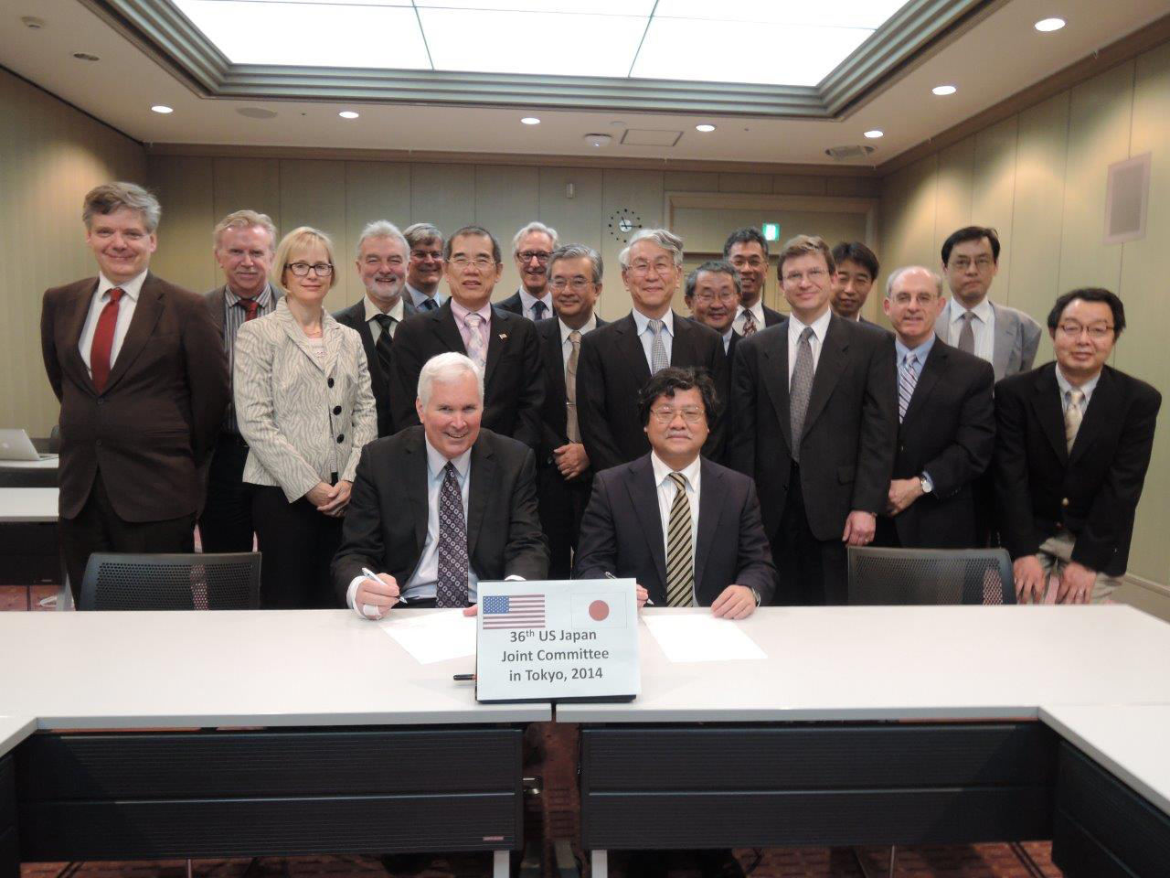 On April 25 in Tokyo, DOE Associate Director for High-Energy Physics Jim Siegrist (seated, left) and KEK Executive Director Yasuhiro Okada (seated, right) signed an agreement on the U.S.-Japan collaboration in high-energy physics. The agreement as it relates to Fermilab covers advanced accelerator technology, including for a linear collider, and the development of advanced technology for neutrino experiments with high-power beams. Photo: KEK