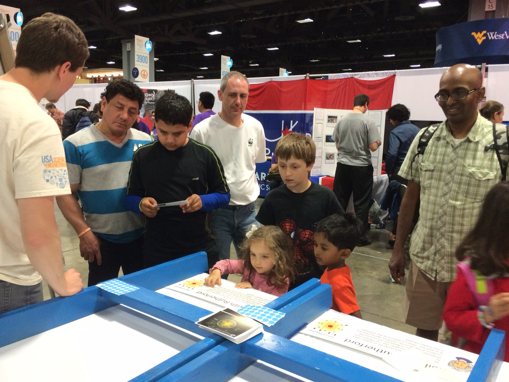 Last month Fermilab participated in the USA Science and Engineering Festival, the largest STEM education event of its kind in the United States. More than 750 organizations participated in the Washington, DC, festival. Here, kids at the Fermilab booth play Rolling for Rutherford. Photo: Marge Bardeen, WDRS