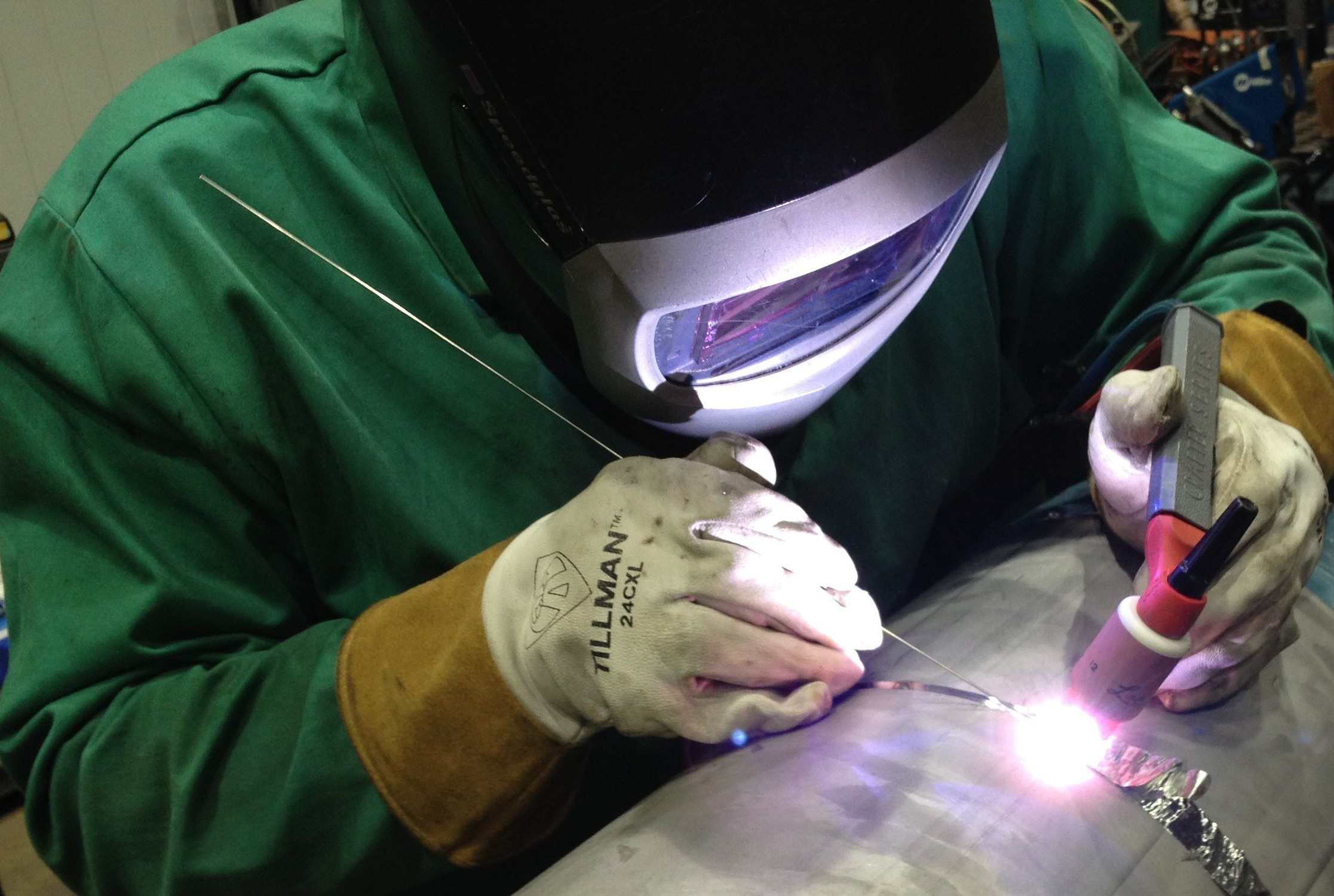 Technical Division's Mike Cooper welds a 12-inch pipe for the SeaQuest berm pipe repair. Environmental conditions for the pipe required a special stainless steel alloy called Duplex 2205, which has higher corrosion resistance than 316 stainless. Photo: Ryan Schultz, AD