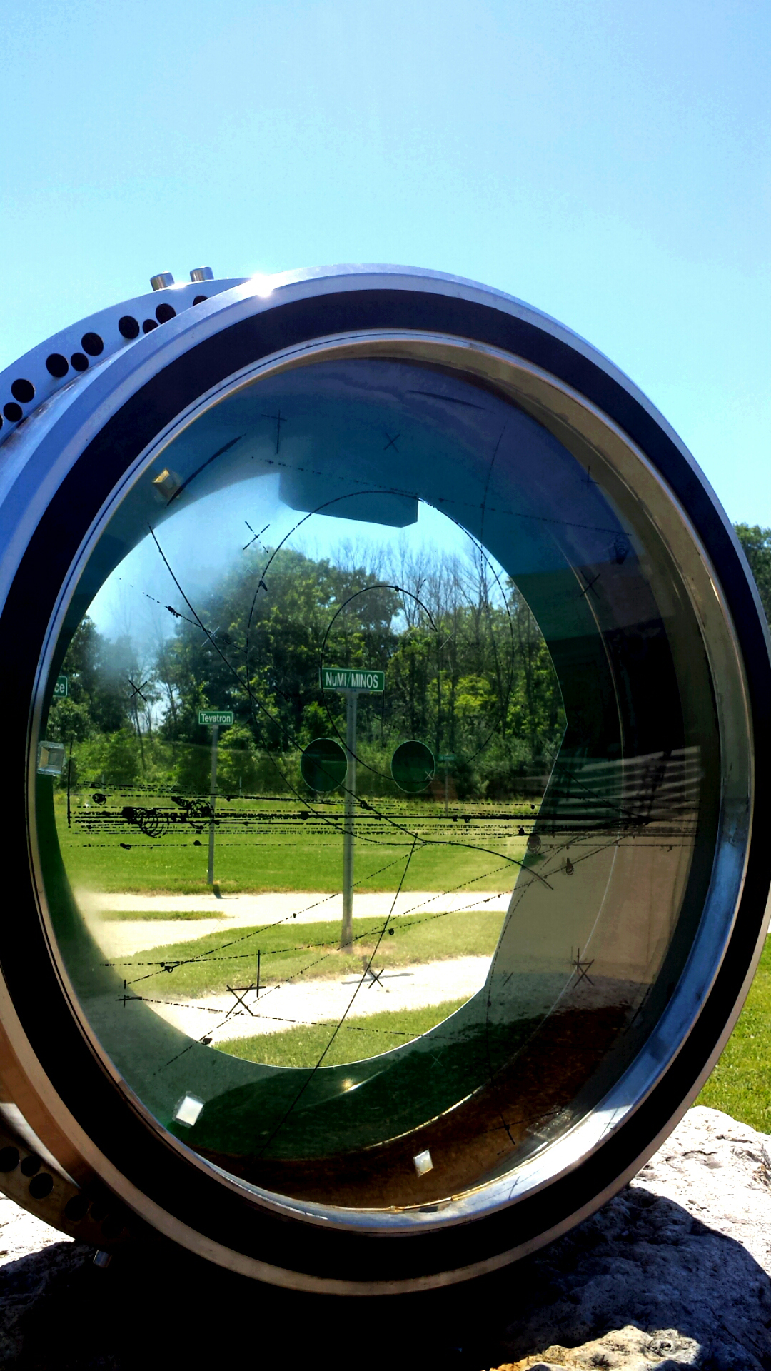 You can see road signs of Fermilab projects through the play bubble chamber. Photo: Mehreen Sultana, WDRS