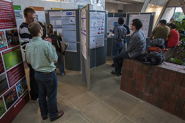 The Fermilab Student and Postdoc Association poster session attracts lots of scientists. Photo: Cindy Arnold. View more photos.