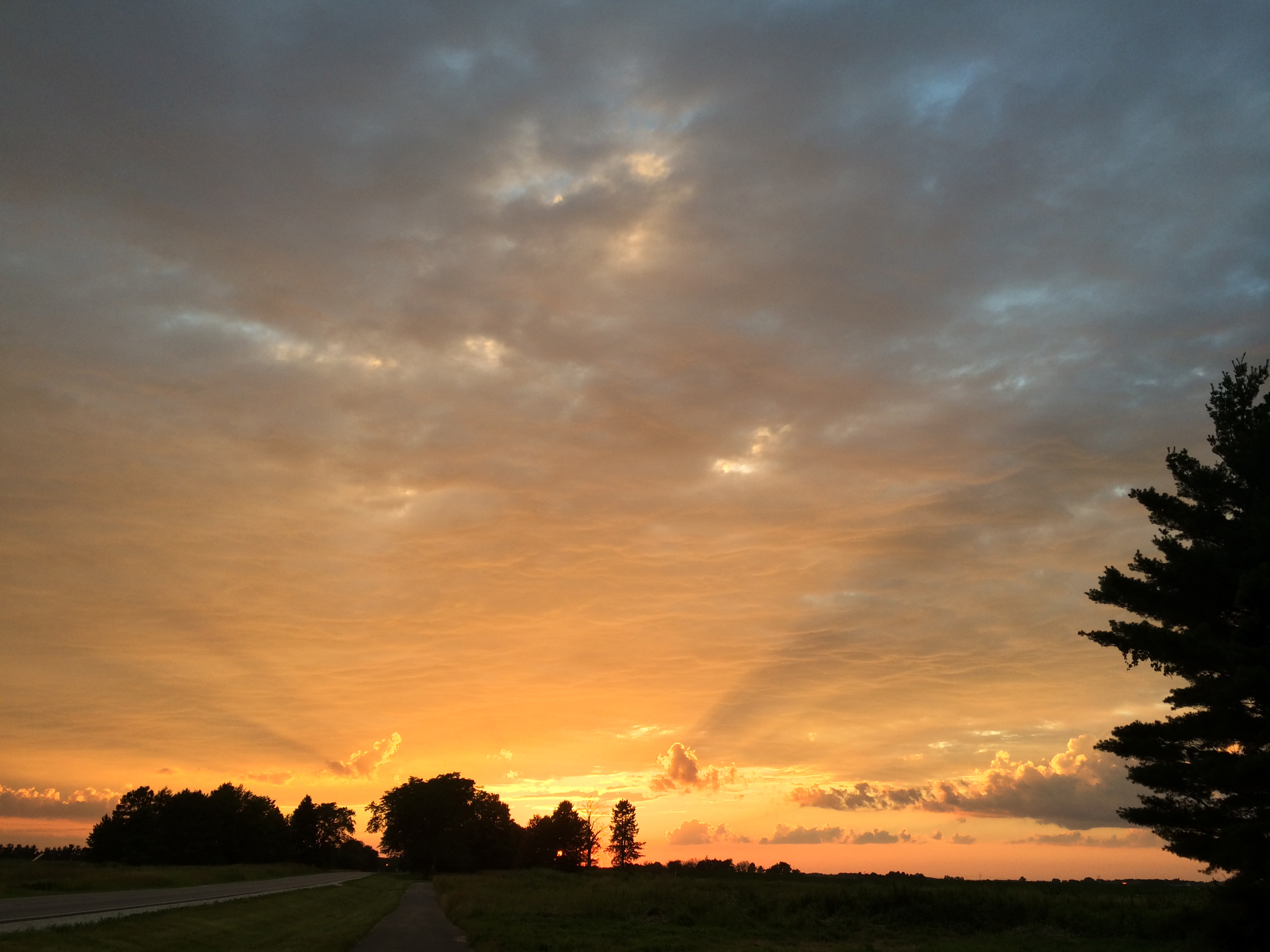 A gorgeous sunset, photographed just west of the Village, illuminates the ceiling of clouds. Photo: Manbir Kaur
