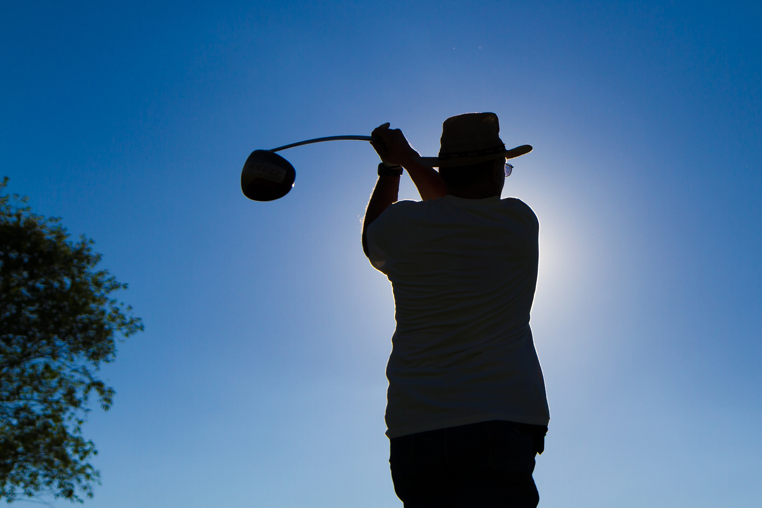 John Voirin, member of PPD and the Wednesday Night Fermilab Golf League at Fox Valley Golf Club in North Aurora, gets ready to swing at the 14th tee. Photo: Elliott McCrory, AD