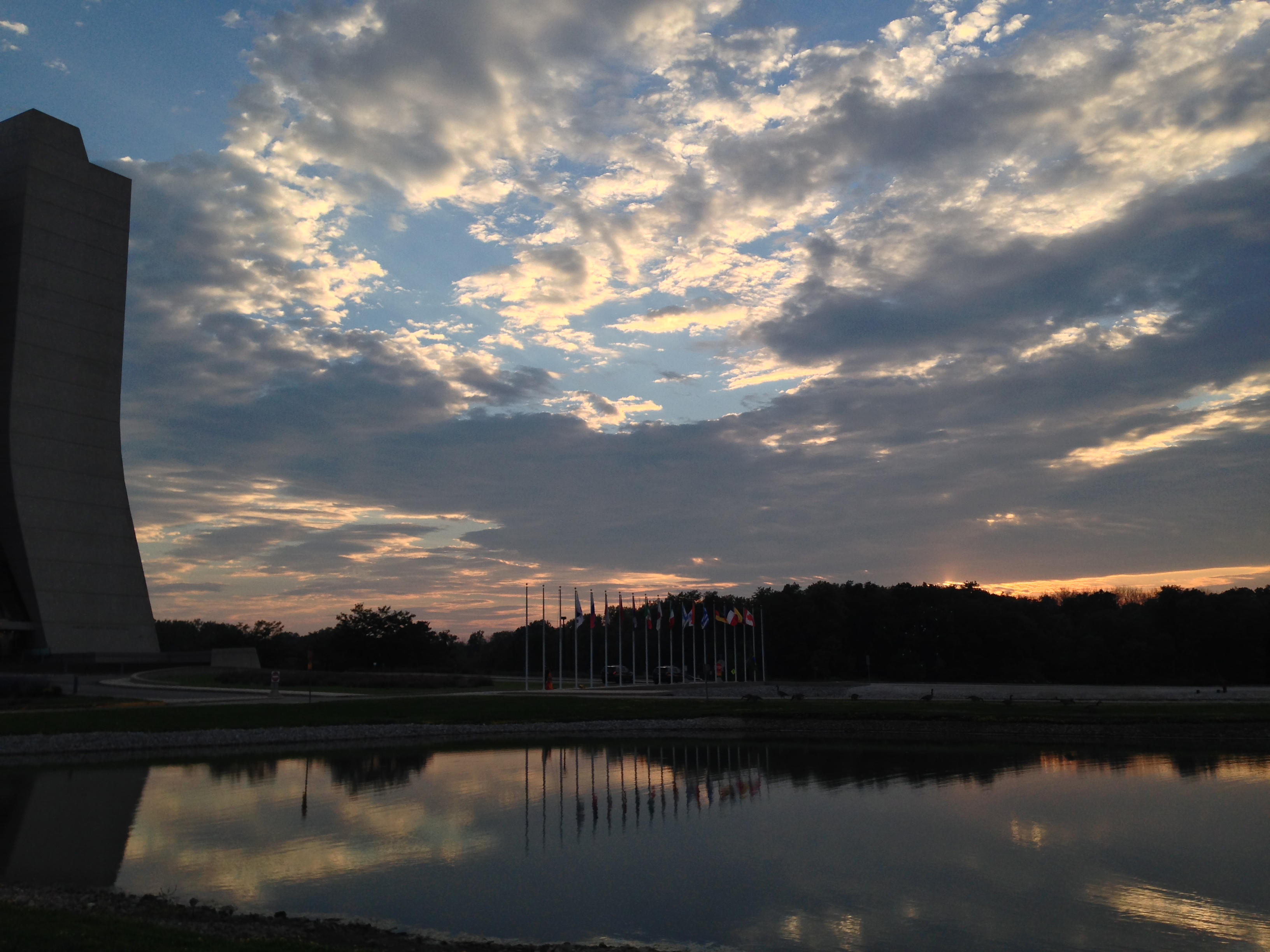 Clouds are scattered across the sky as the sun sets over Fermilab. Photo: Glenn Vallone, ESH&Q