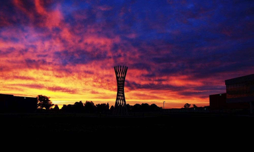 """Fiery hues of Thursday's sunrise fill the sky above """"Tractricious."""" Photo: Greg Vogel, AD"""
