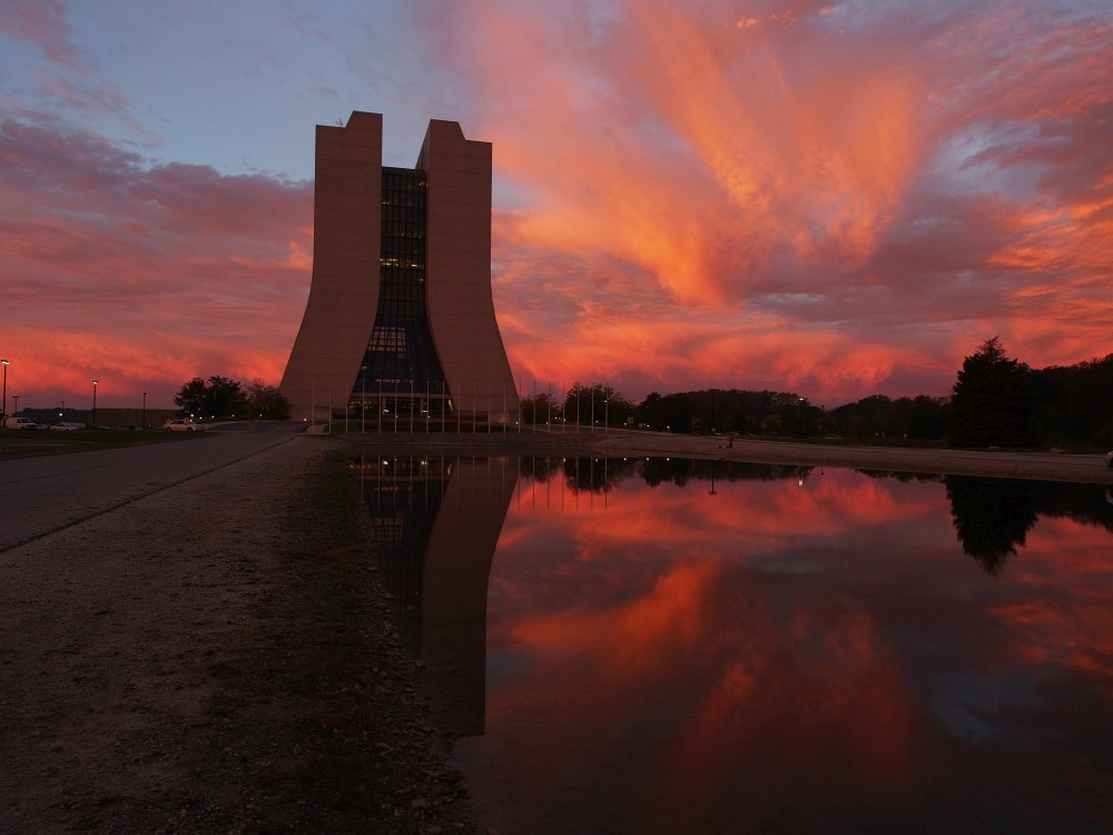 Gorgeous, red-orange clouds over Wilson Hall tell us a new day is dawning. Photo: Greg Vogel, AD