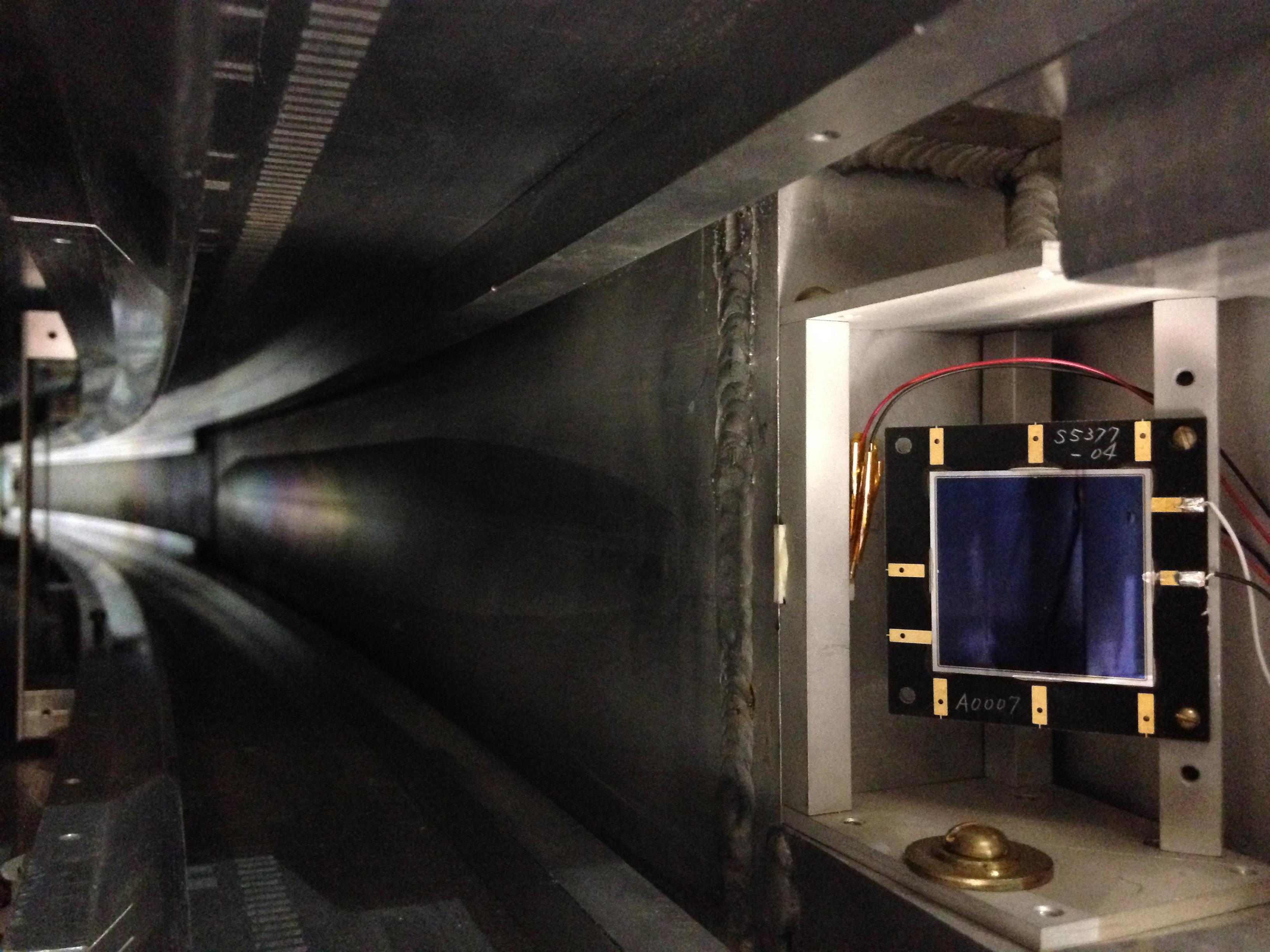 You are looking at a silicon detector at the end of the inflector region of the Muon g-2 experiment. This region is the area in which a specialized magnet bends muons after they exit the Muon Delivery Ring (the former Antiproton Debuncher) and enter the Muon g-2 storage ring, which curves to the left in the picture. This detector was used in the Brookhaven National Laboratory's version of this experiment to record how many muons leave the inflector region. Photo: Erik Ramberg, PPD