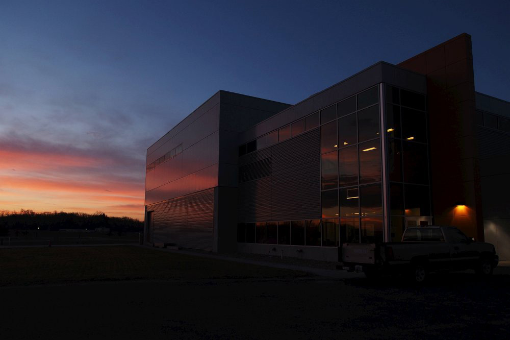 The sun begins to rise over the MC-1 Building Photo: Greg Vogel, AD