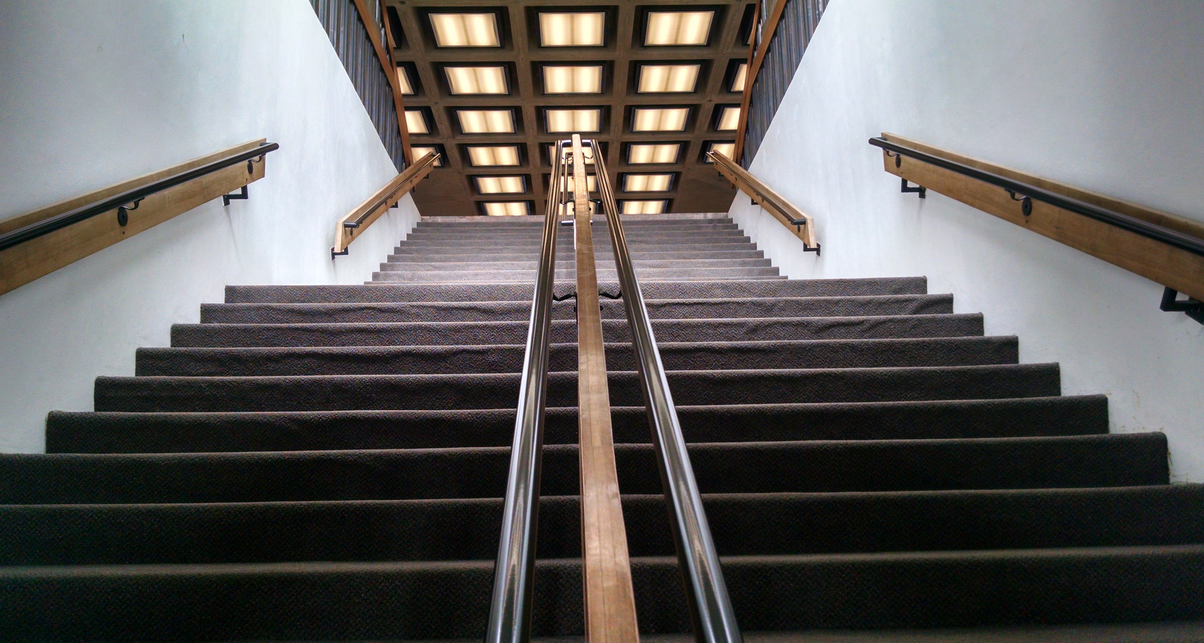 These stairs, familiar to Fermilab staff, connect the hall of oration with the hall of gustation. Photo: Valery Stanley, WDRS
