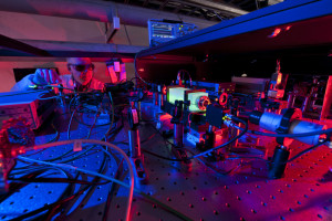 A Fermilab scientist works on the laser beams at the heart of the Holometer experiment. The Holometer will use twin laser interferometers to test whether the universe is a 2-D hologram. Credit: Fermilab.