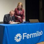 Fermilab Director Nigel Lockyer signs his name in the American Physical Society Register of Historic Sites while Laura Greene, vice president of the APS, looks on. Fermilab was officially designated an APS Historic Site in a ceremony on June 10, 2015 at the laboratory. Photo: Fermilab