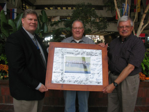 Fermilab scientist and ESH&Q Radiation Protection Manager Don Cossairt, right, receives a Lifetime Achivement Award for accelerator safety. From left: DOE Fermi Site Office Manager Mike Weis, Fermi Site Office Facility Representative Mike Herr, Don Cossairt.