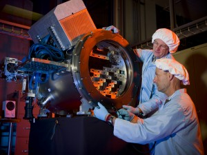 Scientists build a prototype of the Dark Energy Camera, which will survey about one-tenth of the sky to measure 300 million galaxies and discover thousands of supernovae. Credit: Reidar Hahn/Fermilab