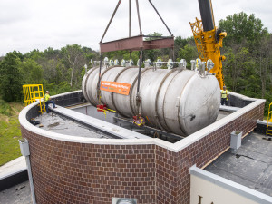 The 30-ton MicroBooNE neutrino detector is gently lowered into the Liquid-Argon Test Facility at Fermilab on Monday, June 23. The detector will become the centerpiece of the MicroBooNE experiment, which will study ghostly particles called neutrinos. Photo: Fermilab.