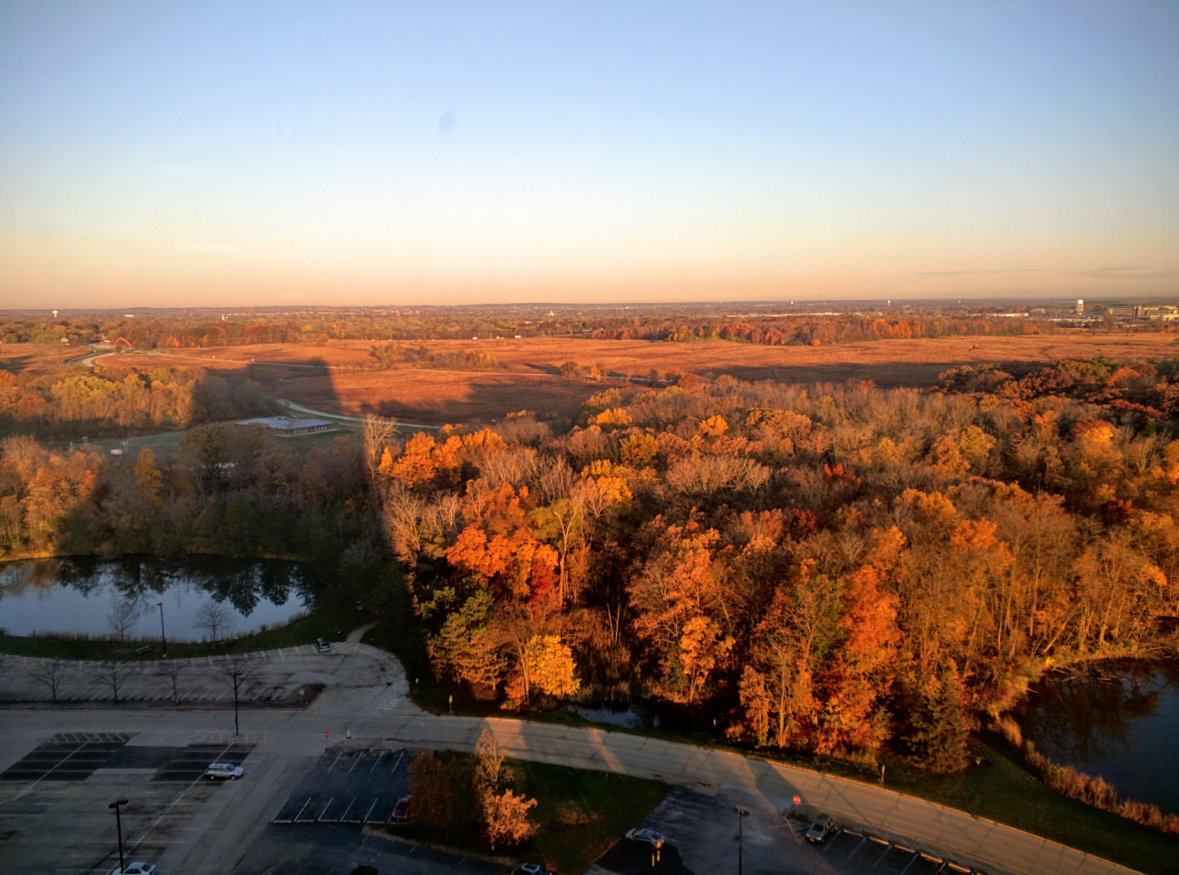 Wilson Hall casts its shadow over a fall landscape. Photo: Valery Stanley, WDRS