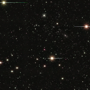 Composite DECam image (combining images from 4 filters) of the cluster of galaxies RXJ 2248-4431. Bright points with horizontal white lines are stars in our own galaxy.