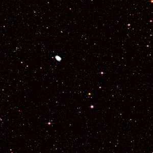 Composite DECam image (combining images from 5 filters) of the cluster of galaxies SPT-CL J2332-5358. The center of the cluster is indicated by the yellowish galaxies in the middle of the picture. The bright galaxy in the upper left is in the foreground (closer to us than the cluster).