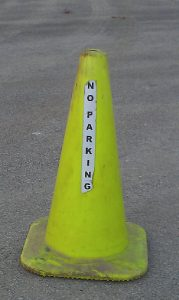 These lime-green cones will mark the special no-parking areas during the winter.