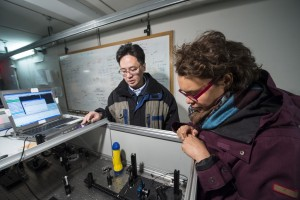Aaron Chou, project manager of the Holometer, and grad student Brittany Kamai work on the laser beam that powers the Holometer. Photo: Fermilab