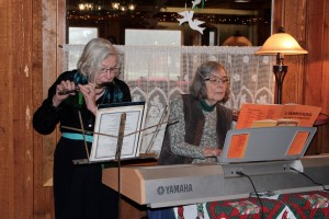 Trish MacLachlan and Linda Newfield playing  holiday music during the NALWO holiday tea. Photo: Georgia Schwender